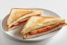 Бутерброды с помидором, ветчиной и сыром